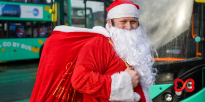 Santa Swaps Sleigh for Stagecoach Bus